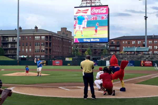 Employee Pitching at Redbirds Game